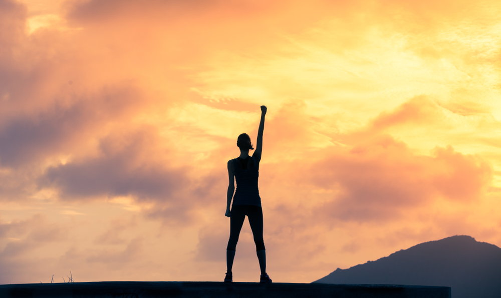 Stand,Strong.,Woman,With,Fist,In,The,Air.,Feeling,Motivated,