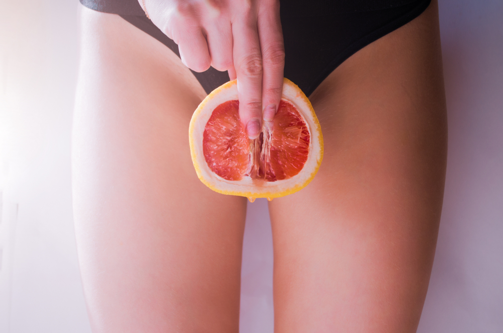 A,Woman,Is,Holding,A,Grapefruit,By,Her,Panties.,Concept